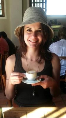 Elena drinking cafezinho